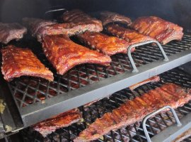 Racks of ribs on a BBQ